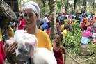 A woman with relief supplies in the village of Lanao del Norte, Philippines