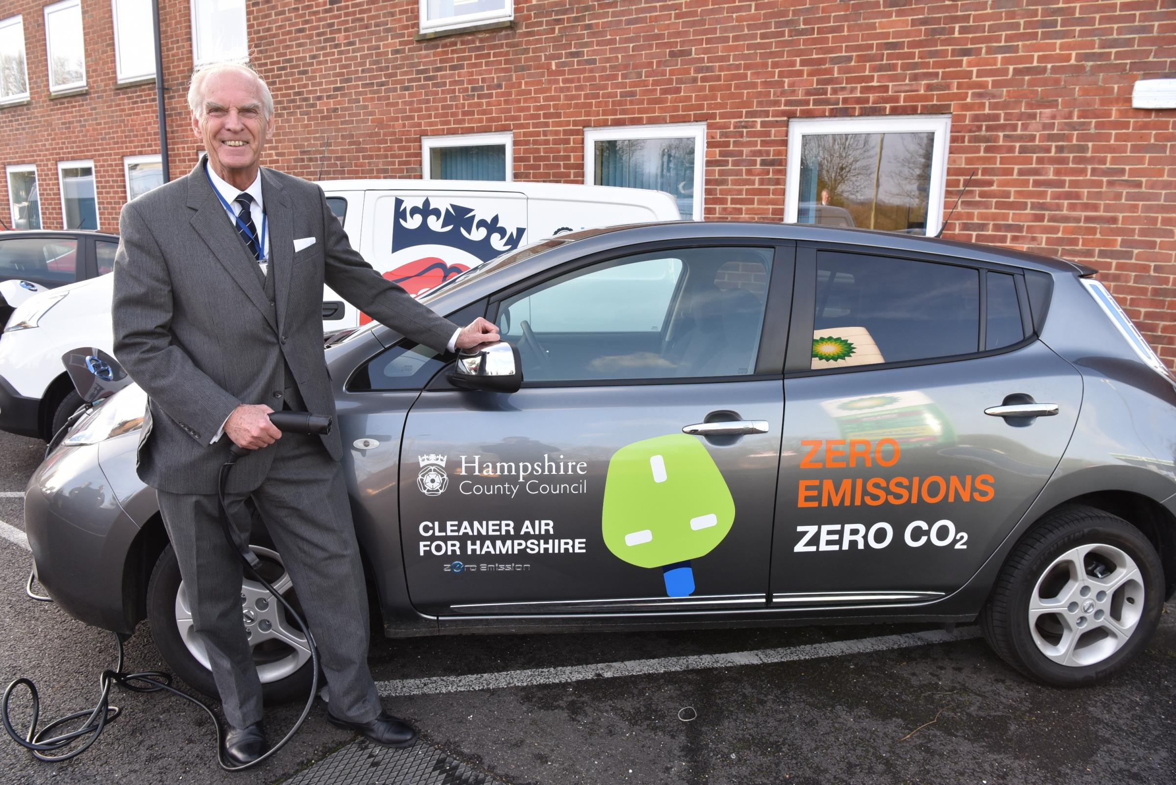 Cllr Mel Kendall and one of the new electric vehicles at Bar End, Winchester