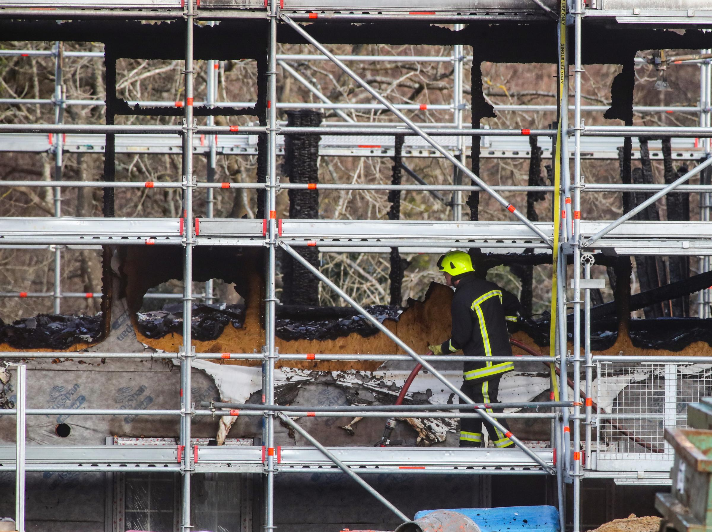 Firemen at the scene of a major fire at the building site on January 6.