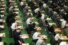 Children should sit exams earlier on in their school career to help them cope with exam pressures, the School Standards Minister has said (PA)