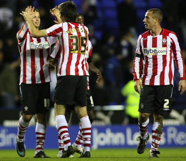 HIGH FIVE: Saints players celebrate a sensational victory at the final whistle.