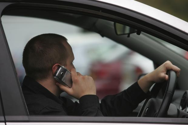 Police crackdown on drivers using their mobiles