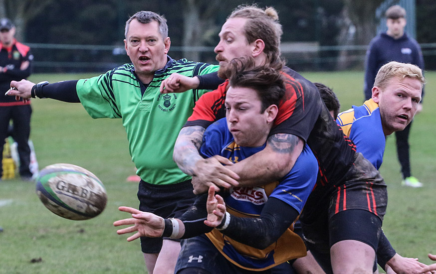 Romsey's Rob Stent is tackled (Photo by Terry Jamieson)