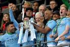 Manchester City remain on course for the treble after winning the Carabao Cup (Joe Giddens/PA)