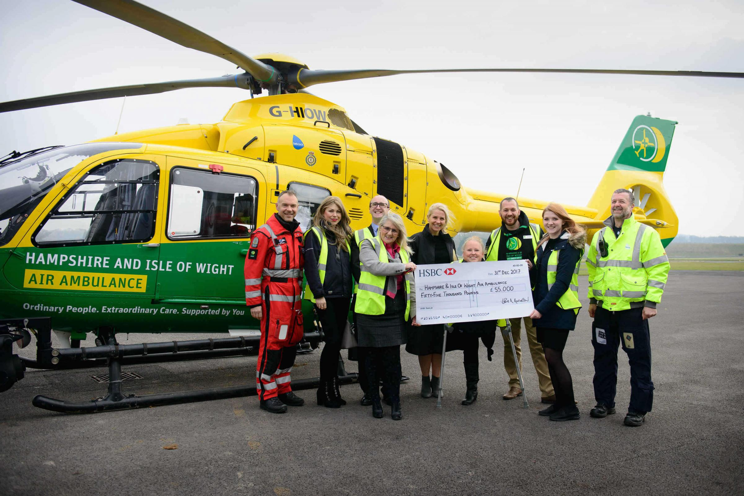 Red Funnel staff present a cheque to the Hampshire and Isle of Wigh Air Ambulance