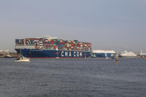 CMA CGM Antoine de Saint Exupery dwarfs the other vessels it passes in the Port of Southampton