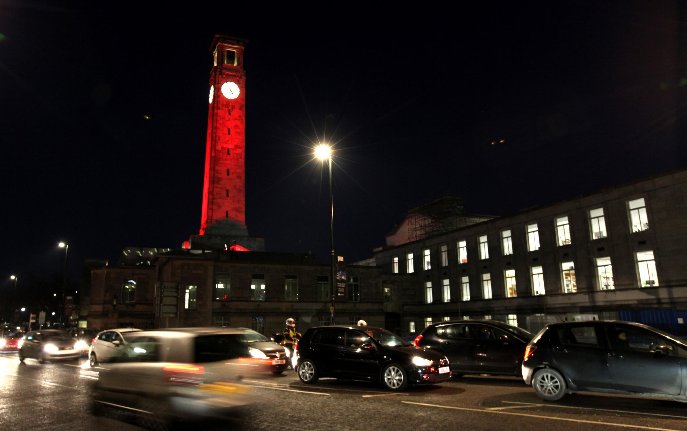 Clock tower at the Civic Centre, Southampton, is illuminated red to mark World Aids Day.         Picture: Chris Moorhouse              Thursday 1st December 2016.