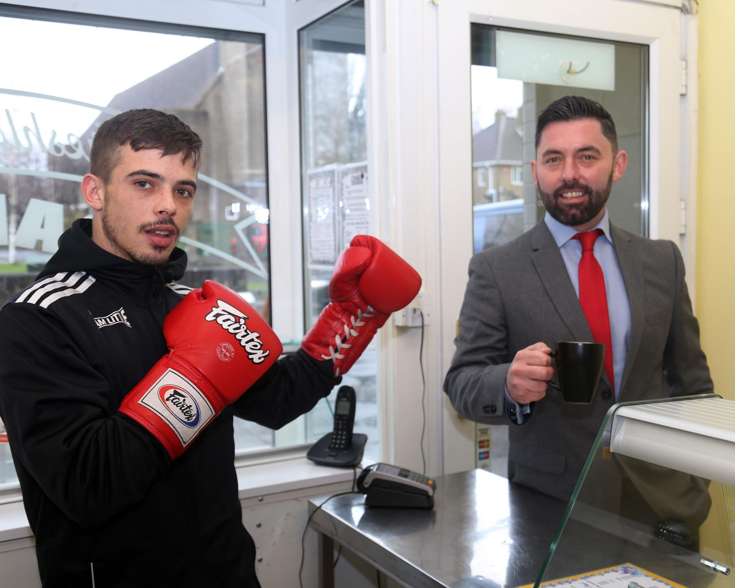 Ricky Little Ricky  with John Scroggins, national valuations manager for Hilton Smythe, at the Bridgeway Cafe which he is selling to pursue a career as a professional boxer