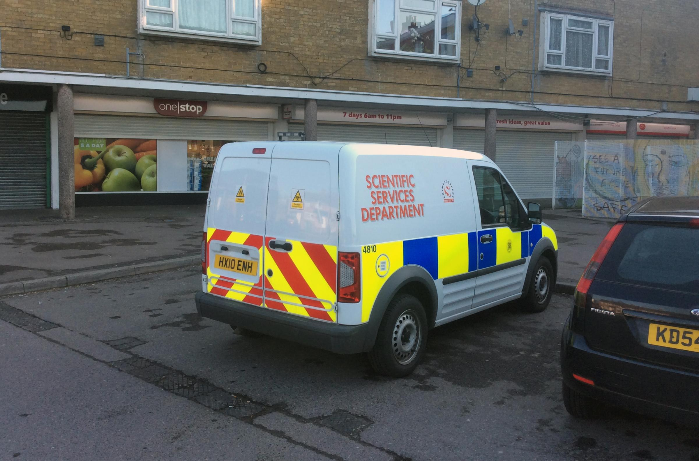 Police at the scene of the incident at One Stop in Kendal Avenue, Millbrook