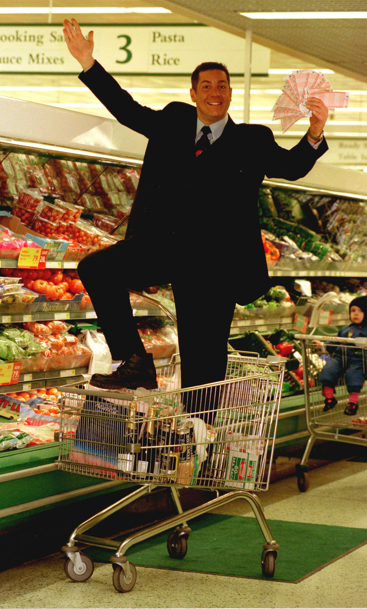 File photo dated 30/11/01 of Dale Winton doing a 'Supermarket Sweep' in Brent Cross, London, to promote the midweek National Lottery. The presenter has died at the age of 62, his agent has said. PRESS ASSOCIATION Photo. Issue date: Wednesday April