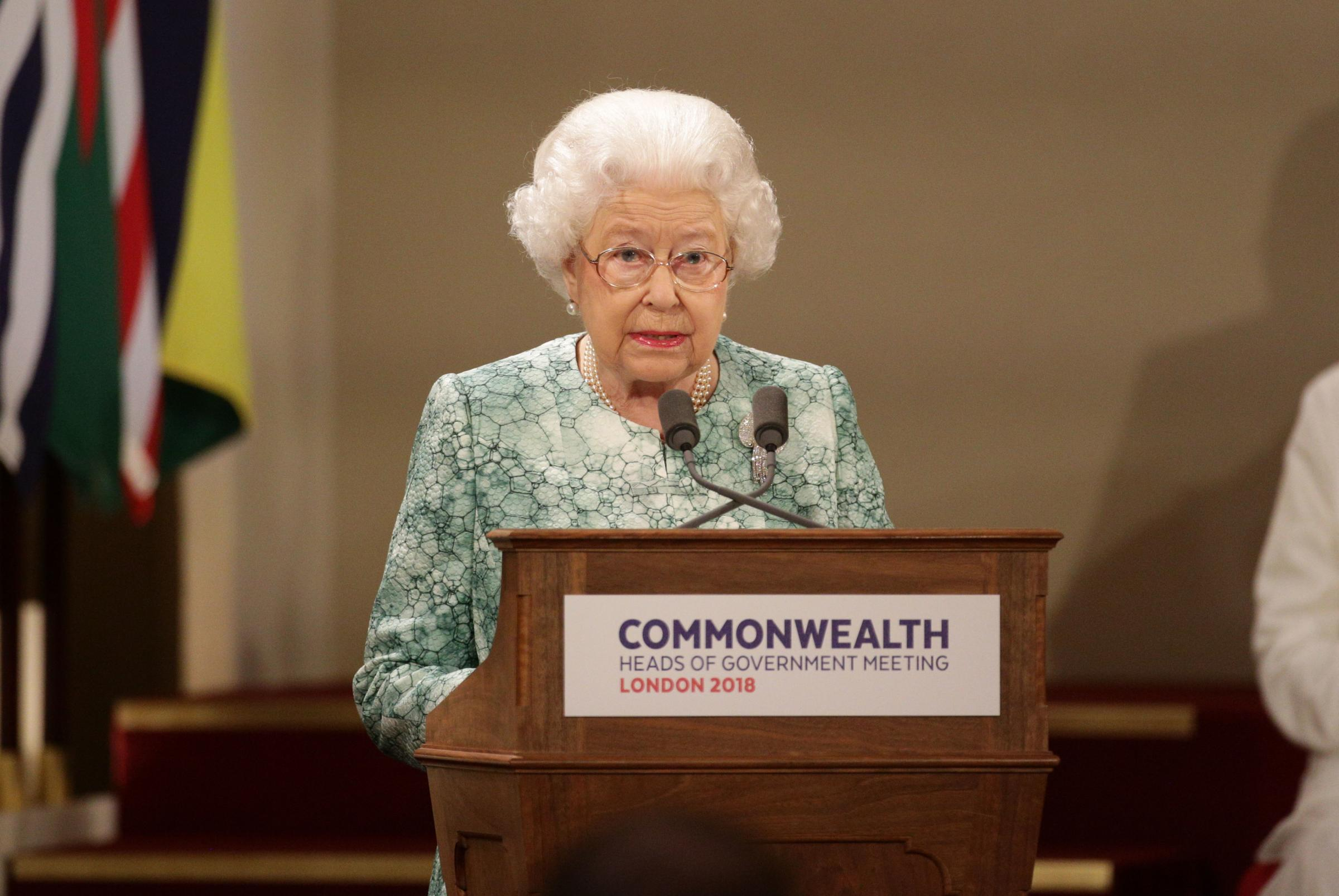 Queen Elizabeth II speaks at the formal opening of the Commonwealth Heads of Government Meeting in the ballroom at Buckingham Palace in London (Yui Mok/PA Wire)