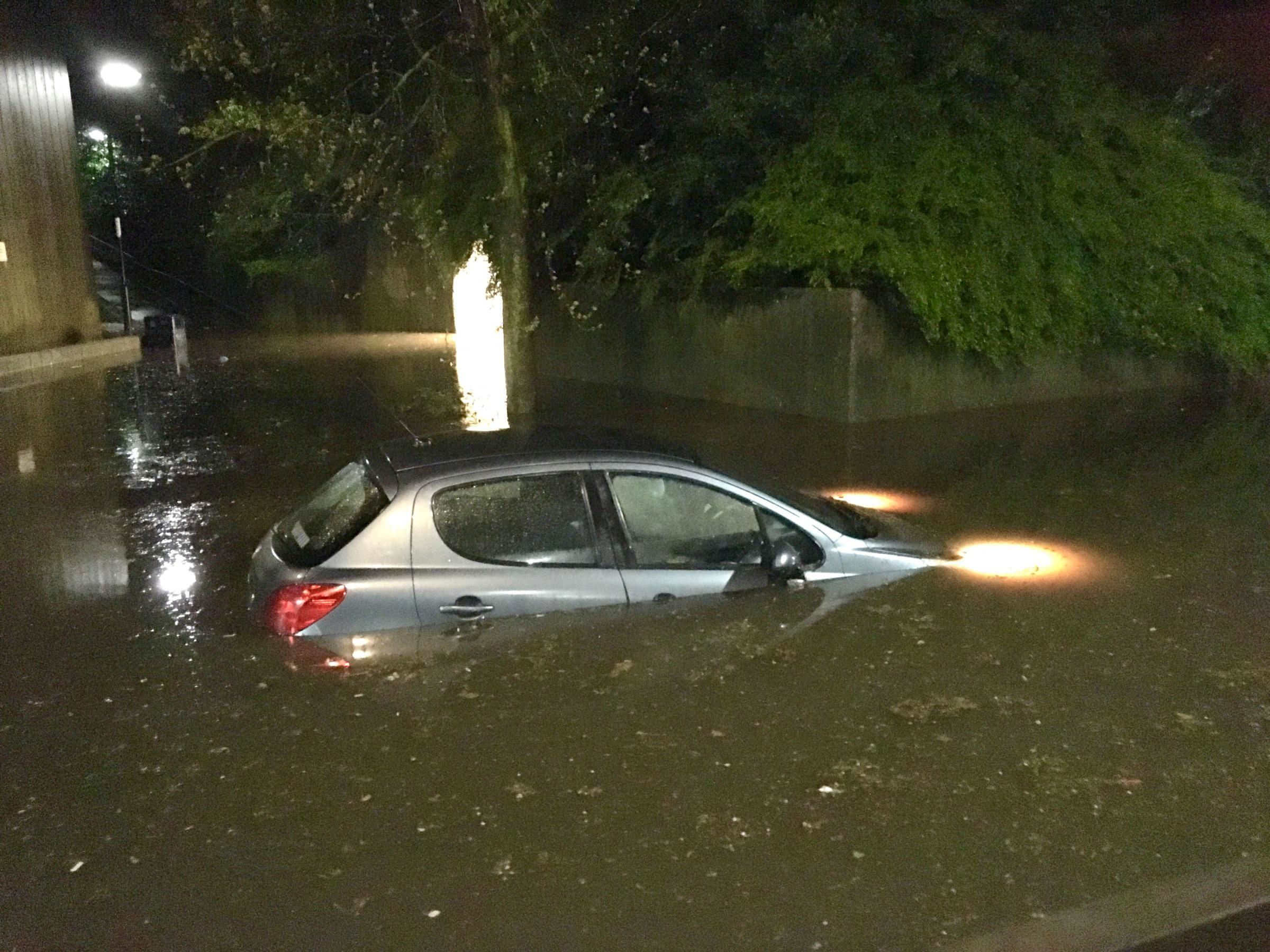 A car under water following a flash flood near the Itchen Bridge