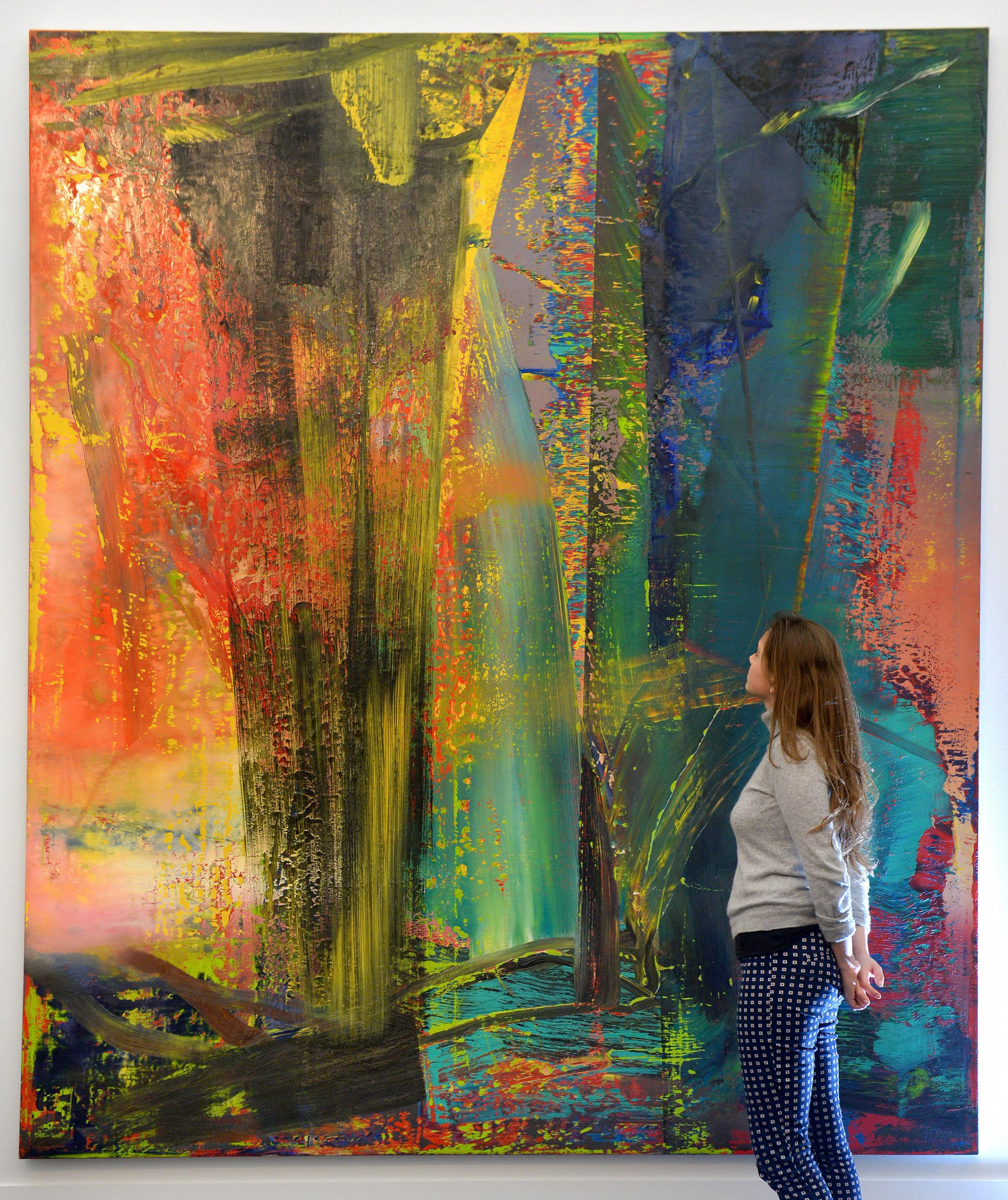 File photo dated 27/01/2015 of a woman viewing Gerhard Richter's Abstraktes Bild at Sotheby's auction house in London, the painting has sold for £30.4 million at their Titans of Contemporary Art sale. PRESS ASSOCIATION Photo. Issue da
