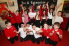 Beechwood Junior School pupils celebrate after raising over £1,000 to fund a trip to see War Horse.