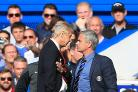 Chelsea manager Jose Mourinho (right) has a heated exchange with Arsenal manager Arsene Wenger (left) on the touchline during the Barclays Premier League match at Stamford Bridge, London.