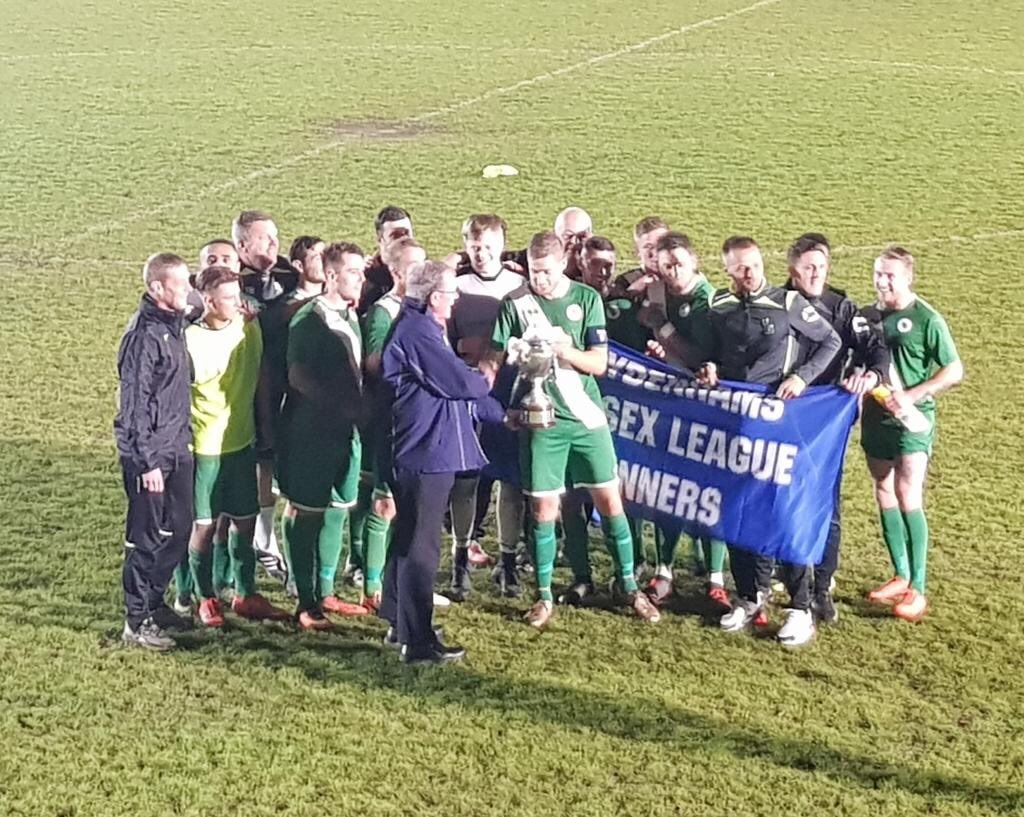Blackfield's players and management team win the Sydenhams Premier title last season. Chris Farrell is pictured in the middle of the back row.