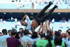 File photo dated 06-05-2018 of Manchester City manager Pep Guardiola is thrown up into the air by players during the Premier League trophy celebrations after the Premier League match at the Etihad Stadium, Manchester.