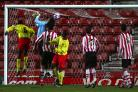 The winning goal for Watford as Edward Oshodi (6) heads home.