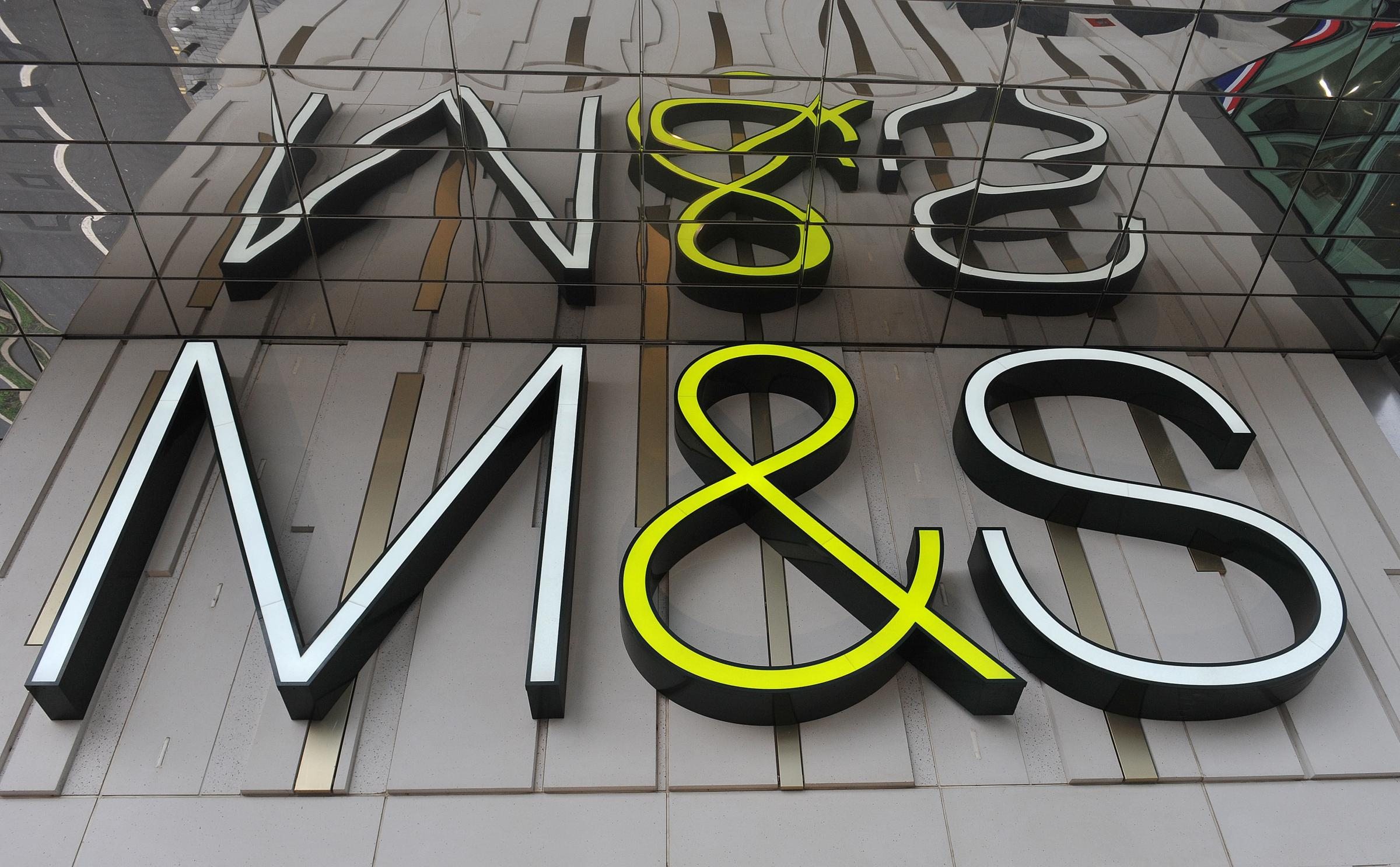 File photo dated 23/10/12 of a Marks and Spencer sign as the company said it is to close 100 stores by 2022 as it accelerates a transformation programme. PRESS ASSOCIATION Photo. Issue date: Tuesday May 22, 2018. See PA story CITY Marks. Photo credit shou