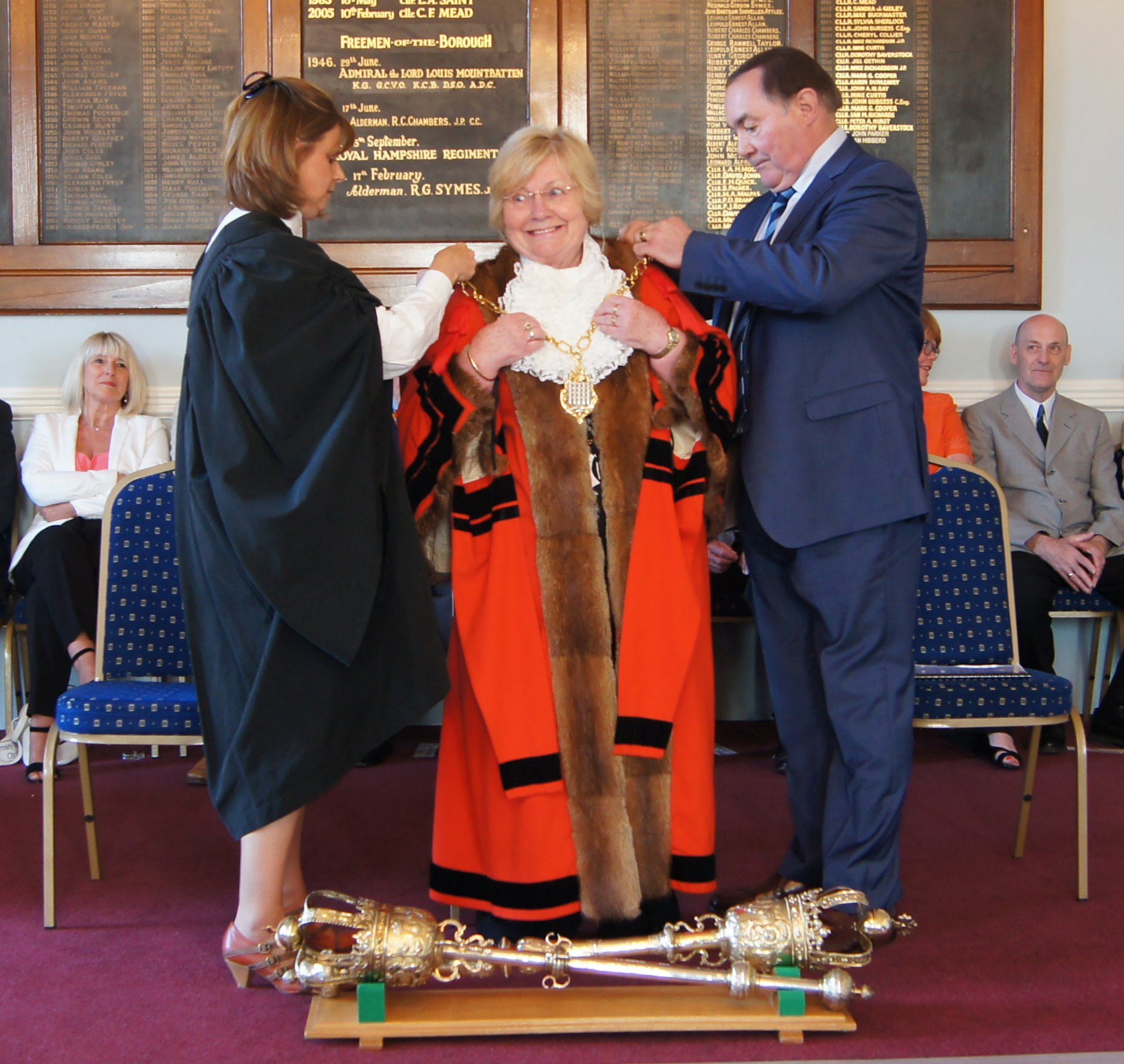 Cllr Hibberd, right, lends a hand at the mayor making ceremony of cllr Dorothy Baverstock
