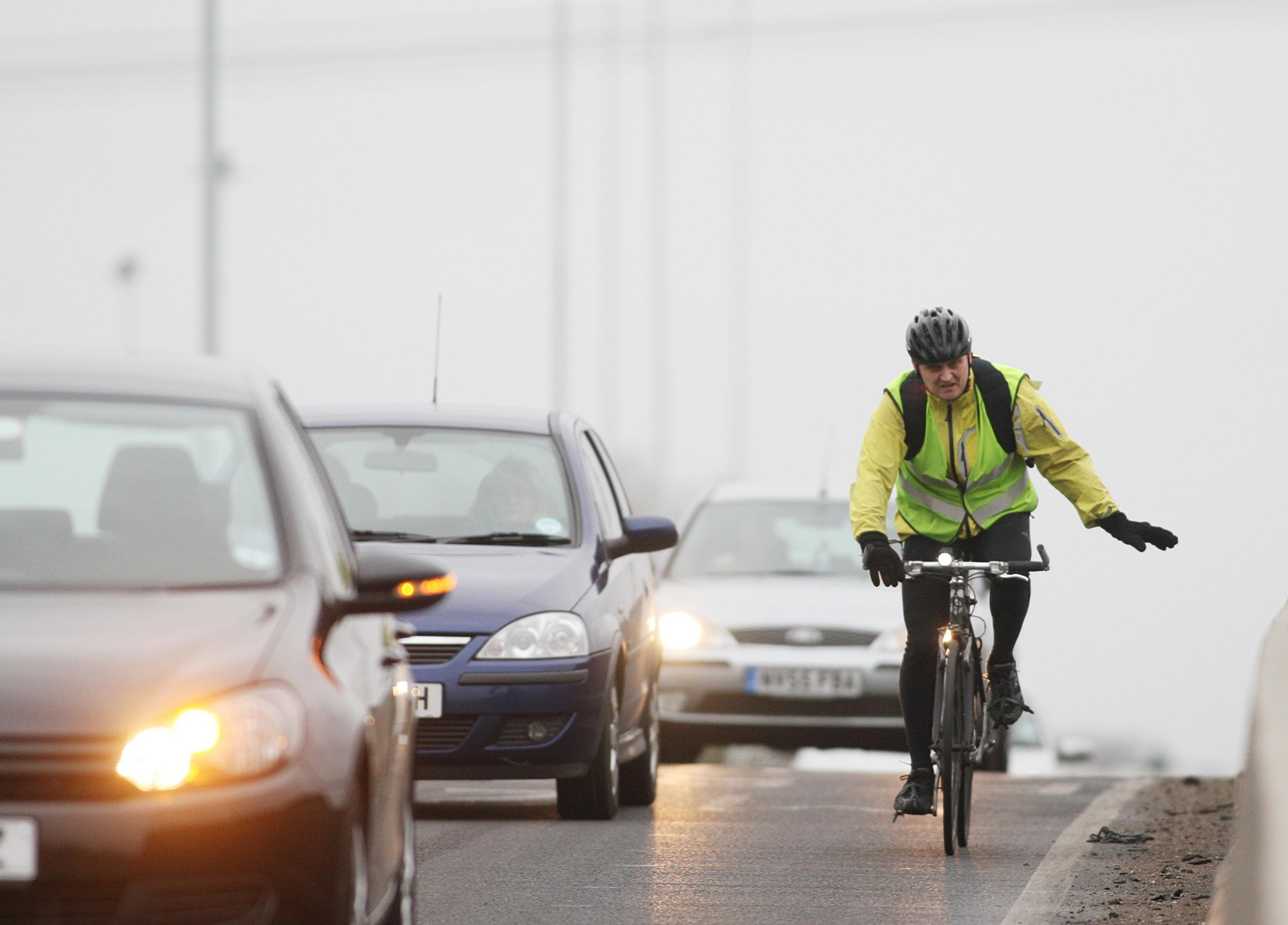 22 Feb 2012 - Cyclist Bike Cycling stock photo of a cyclist in heavy traffic in Southampton.