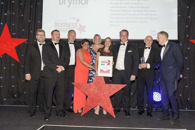 South Coast Business  with Sir Geoff . Winchetrser Motor Group Customer service award Winners Brymor Construction.