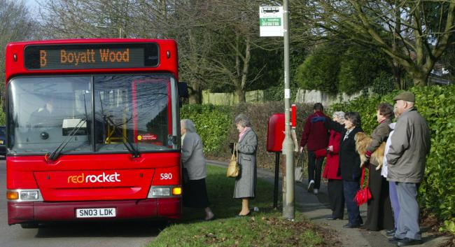 Bus stop on Highcliffe Drive, Eastleigh, Joan Calvey and friends gather to protest about the cuts of red Red Rocket buses