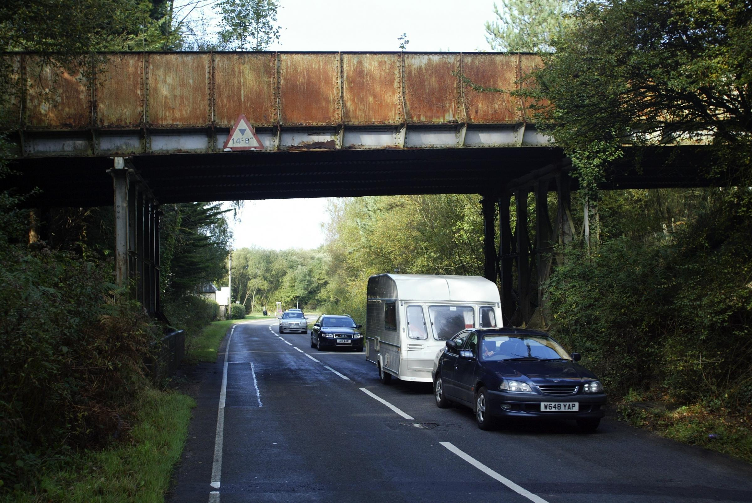 Work starts on the A35..traffic makes it's way from Burley towards Brockenhurst under the road bridge at Holmsley , which needs major work carried out on it.