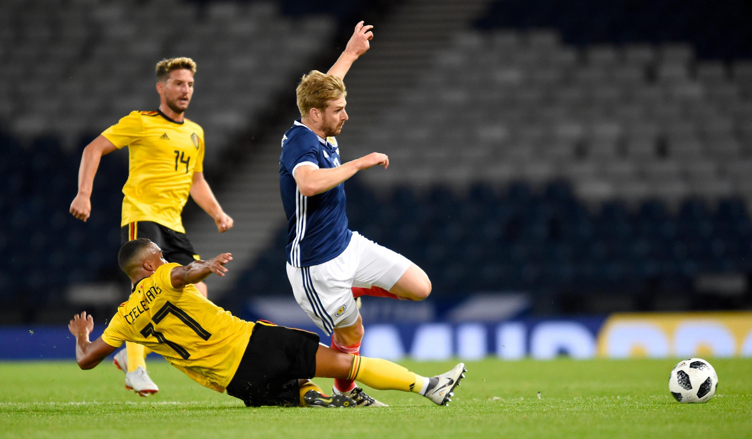 Stuart Armstrong is tackled by Youri Tielemans