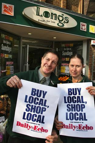BUY LOCAL: Mark Stewart and Judy Twamley outside Long's Fresh For Less in Eastleigh.