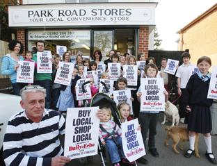 BACKING CAMPAIGN: Shop owner Paul Pace with some of his customers.  Echo picture by Malcolm Nethersole.   Order no: 8268393
