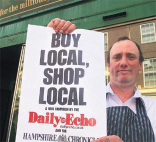 CHOP TO IT: Baynhams Butchers relief manager Gary Smith backs buying locally. Photo: Matt Watson Order no: 8290933