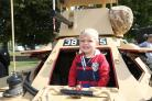Eastleigh Remembers event at Leigh Road recreational ground - 3 year old Alfie Brooker-Duncan pictured in a Ferret armoured car.