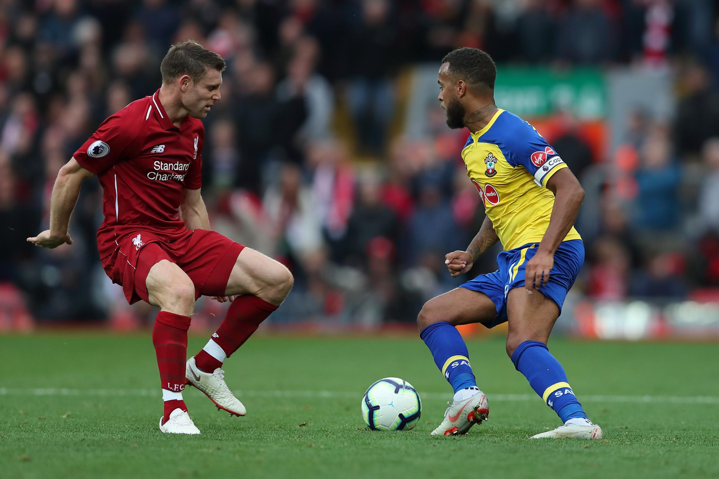 Ryan Bertrand takes on James Milner at Anfield on Saturday