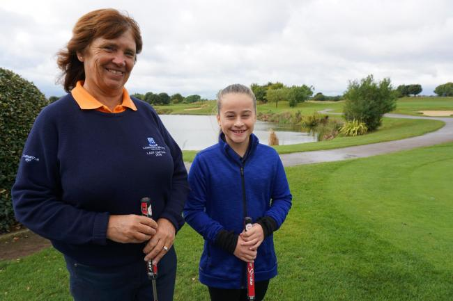 Schoolgirl Poppy Cooper with Cams Hall Estate Golf Club's ladies' captain Lt Commander Isabel Kent RN (rtd)