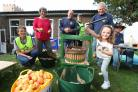 Alresford Apple Day at St John's Church - 5 year old Emma Field helps the Alresford Rotary Club press the apples.