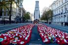 Wreaths cover the ground following the remembrance service at the Cenotaph memorial in Whitehall, central London, on the 100th anniversary of the signing of the Armistice which marked the end of the First World War. PRESS ASSOCIATION Photo. Picture date: