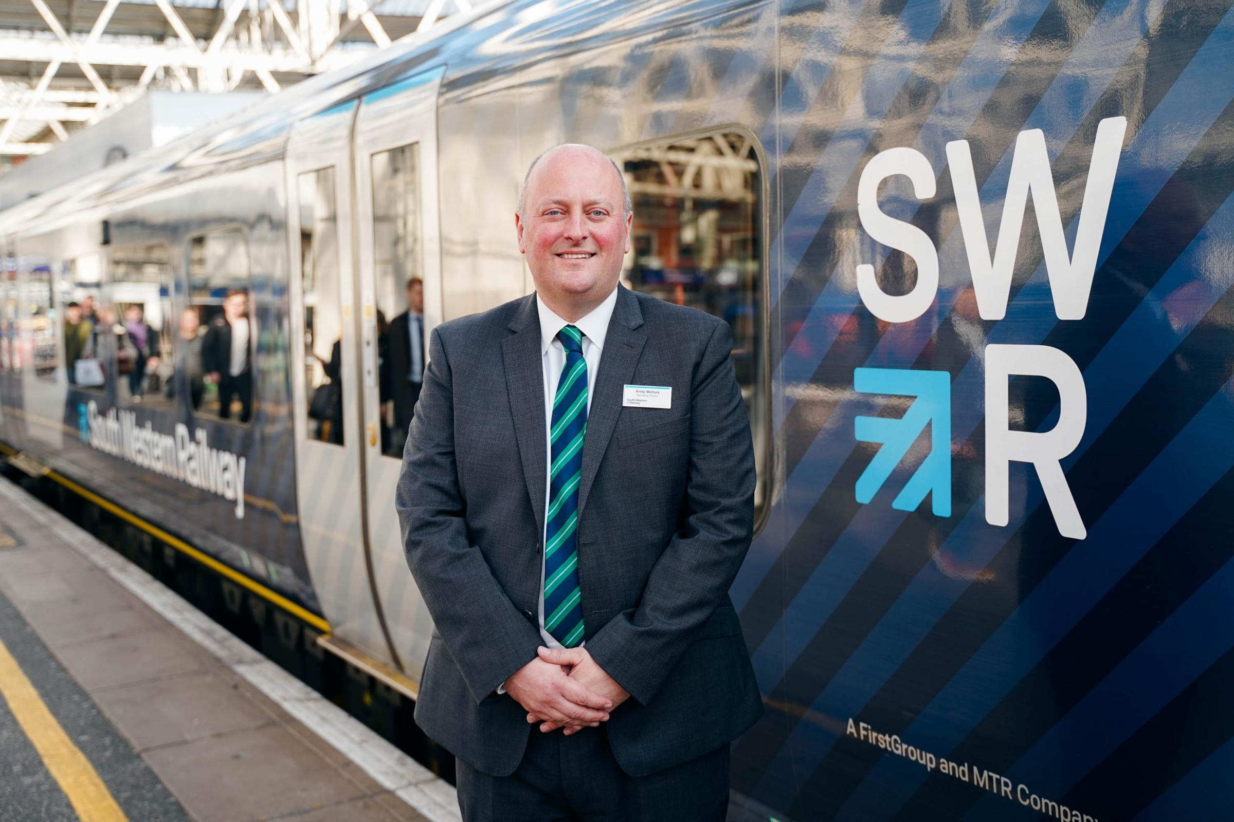 Pic from Chris.Hudson@swrailway.com South Western Railway managing director Andy Mellors with the first in a fleet of refurbished Class 444 trains