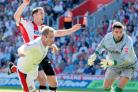 SCOW SCORES: Jamie Scowcroft completes his treble at St Mary's in August 2007.