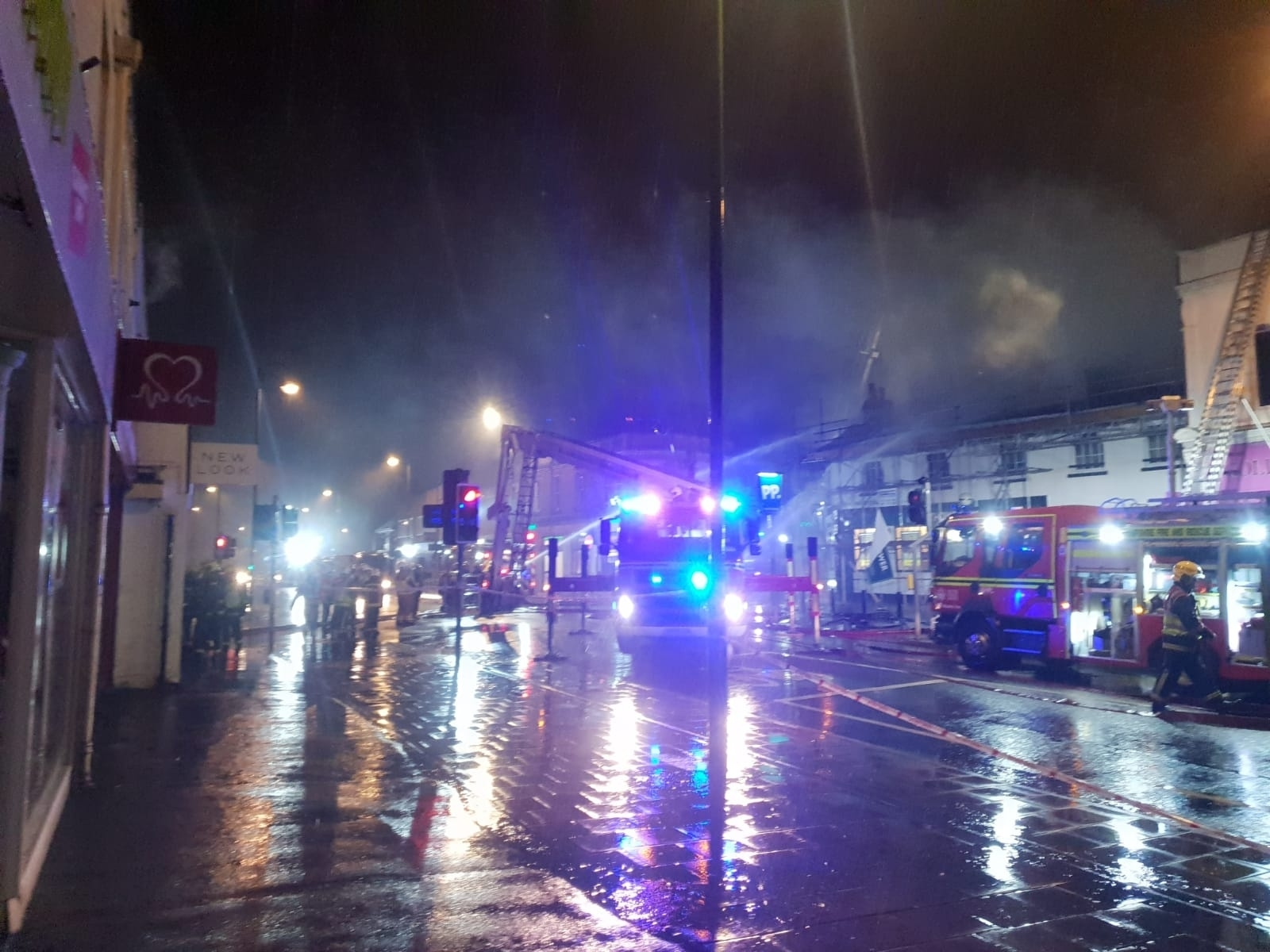 Firefighters tackle the blaze above Paddy Power in Shirley High Street.