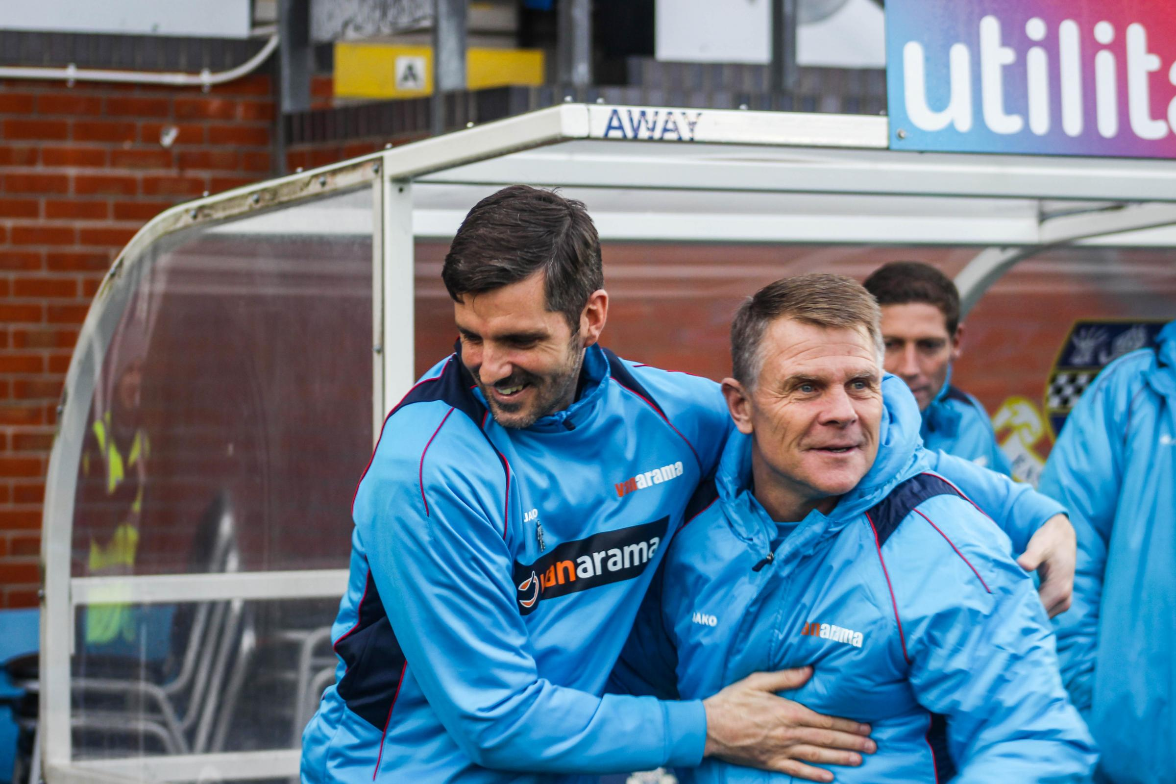 Eastleigh boss Ben Strevens (left) hugs Andy Hessenthaler before kick-off against Dover (photo: Tom Mulholland)