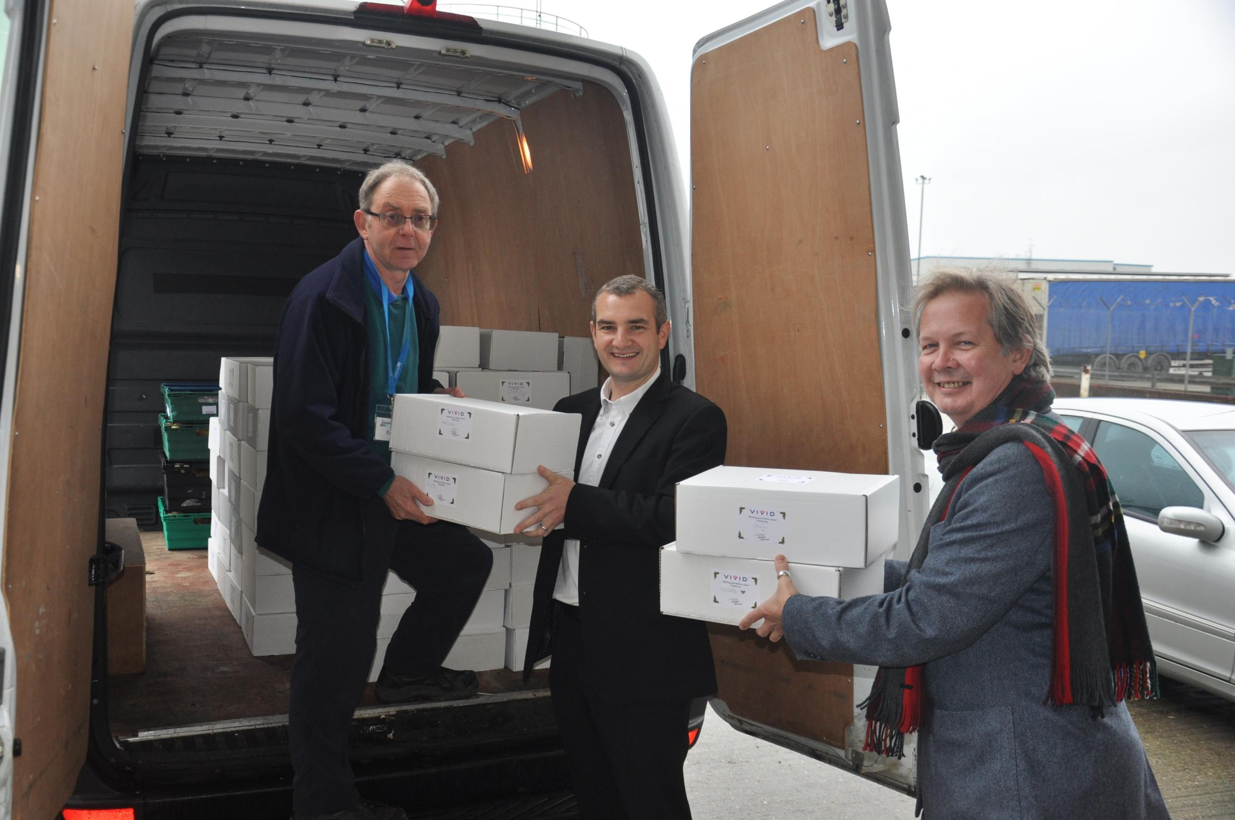 Southampton City Mission volunteer Ken Casey is helped by VIVID Director of New Business and Development Mike Shepherd and Director of Resources Duncan Short.