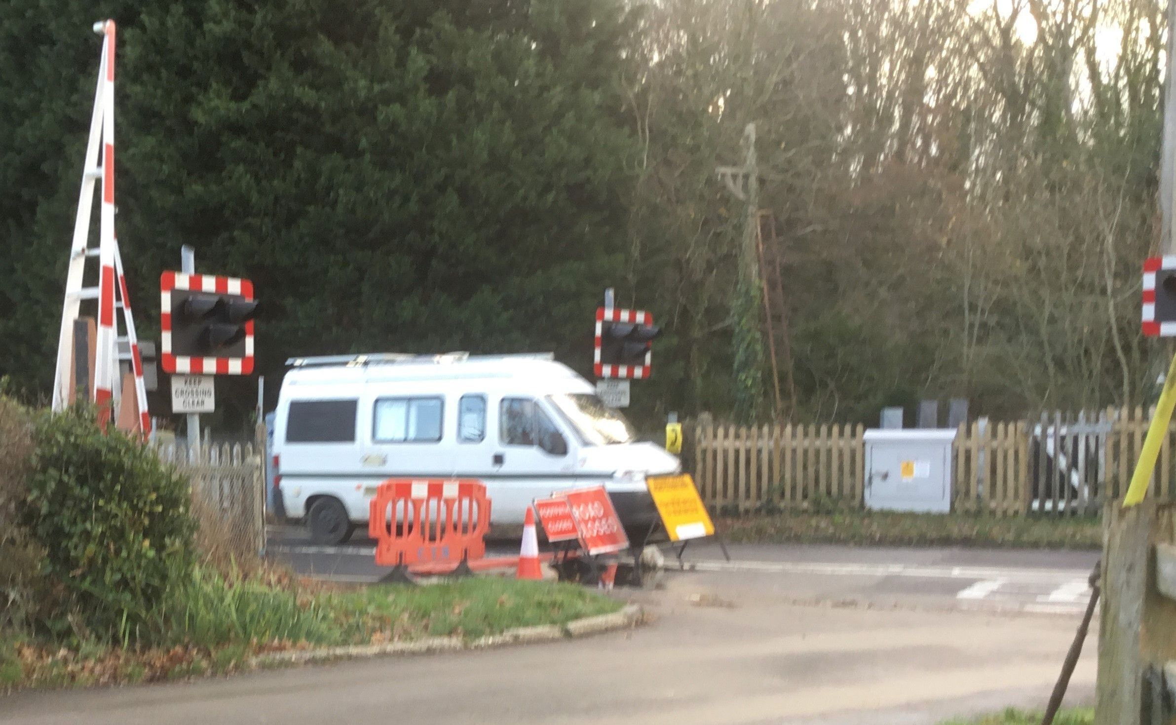 A vehicle appears to cross the closed level crossing on Frost Lane in Hythe.