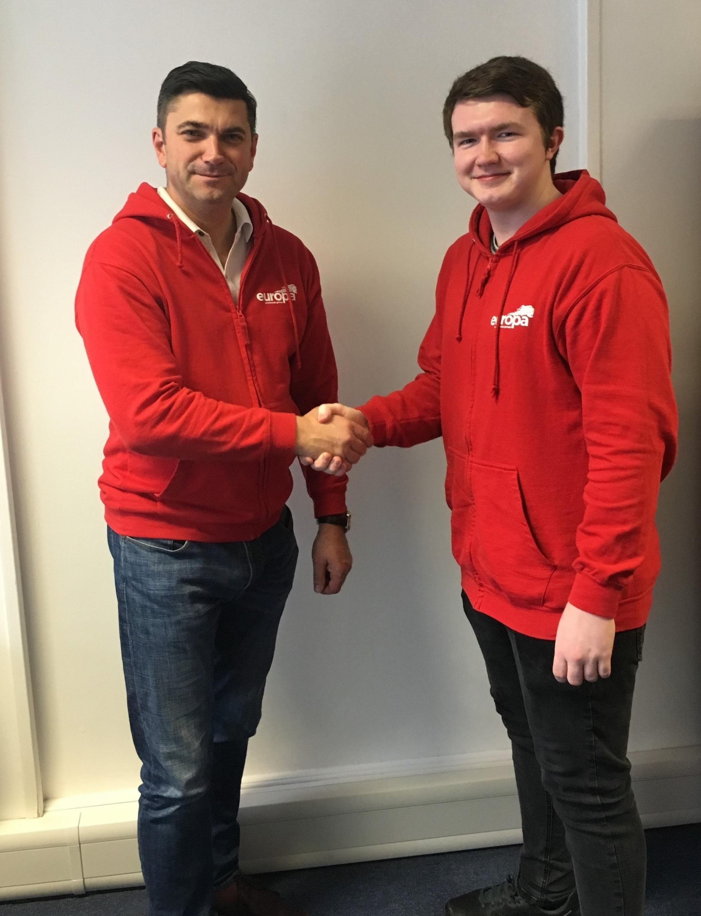 Europa branch manager John Moy welcomes school leaver Joe Tuck to the firm