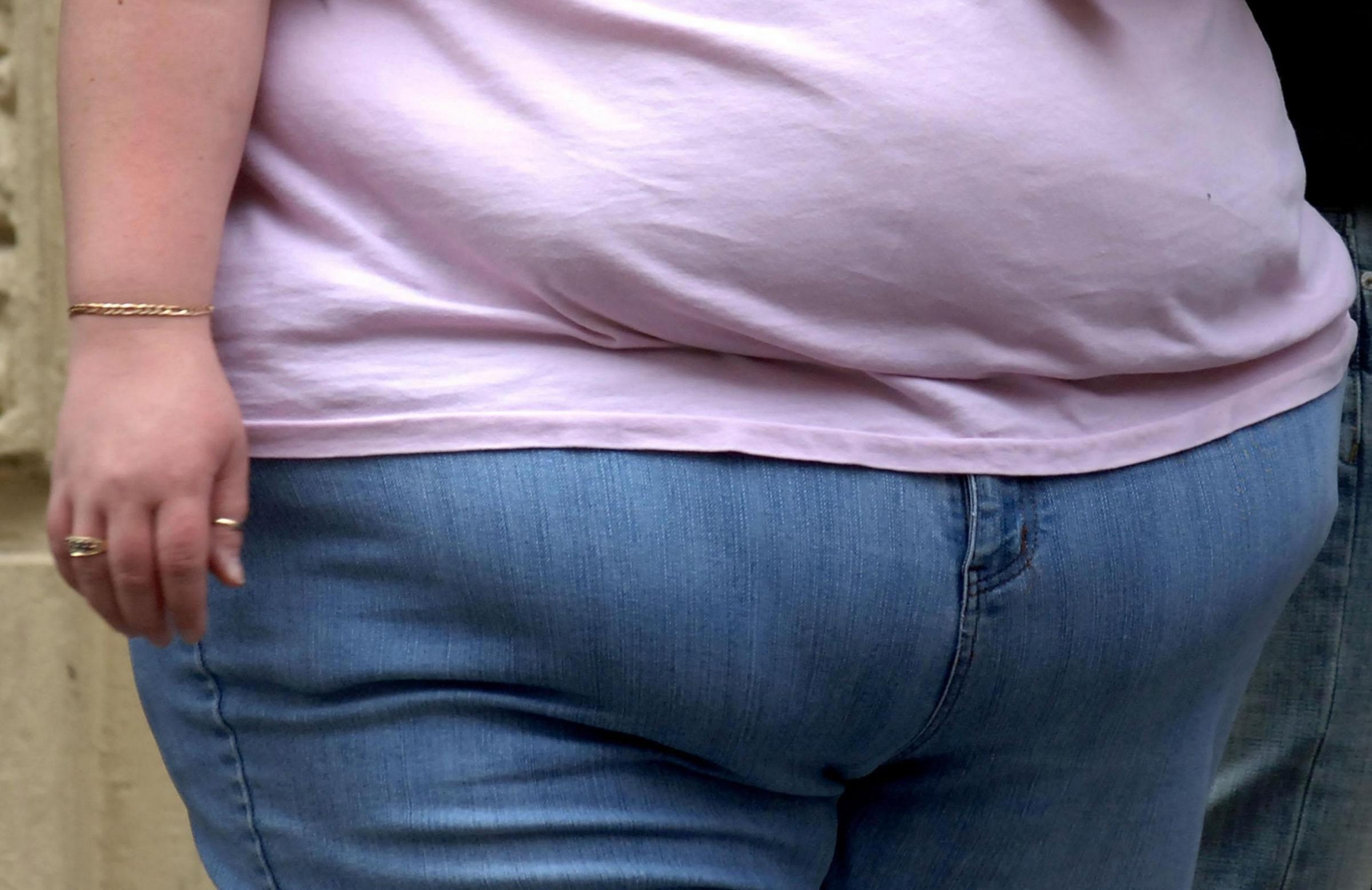 File photo dated 08/06/07 of the waist of an obese woman, as new figures show that the number of obese people who need to be moved by firefighters is on the rise. PRESS ASSOCIATION Photo. Issue date: Monday September 19, 2016. Data obtained by BBC Radio 5