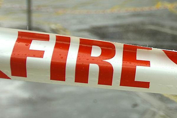 Man arrested after fire at village home being treated as arson