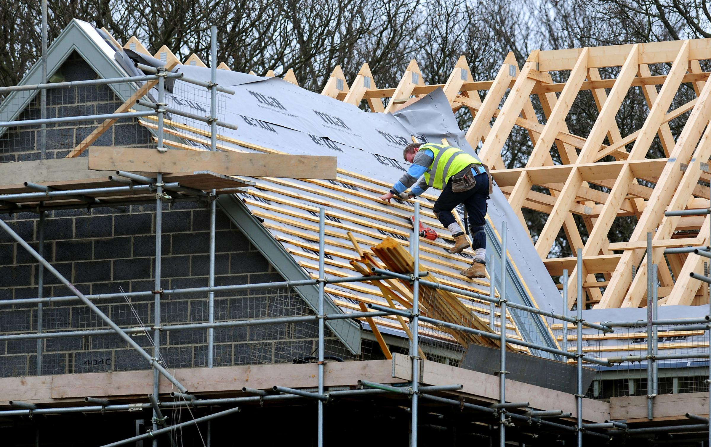 File photo dated 28/2/12 of a general view of roof workers building new houses in Derbyshire as a surge in housebuilding spurred a new wave of optimism in the construction sector as it achieved its best performance for three years, figures have showed..