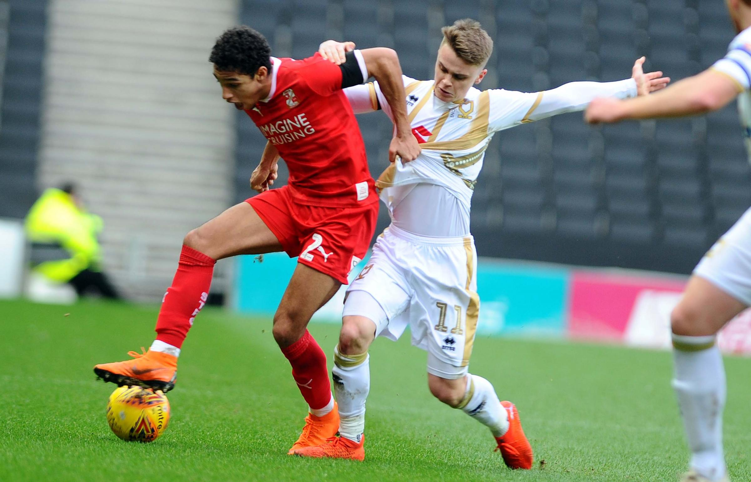 Jake Hesketh in action for MK Dons
