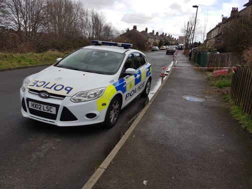 Police at the scene in Bluebell Road, Southampton, where a teenager was shot.
