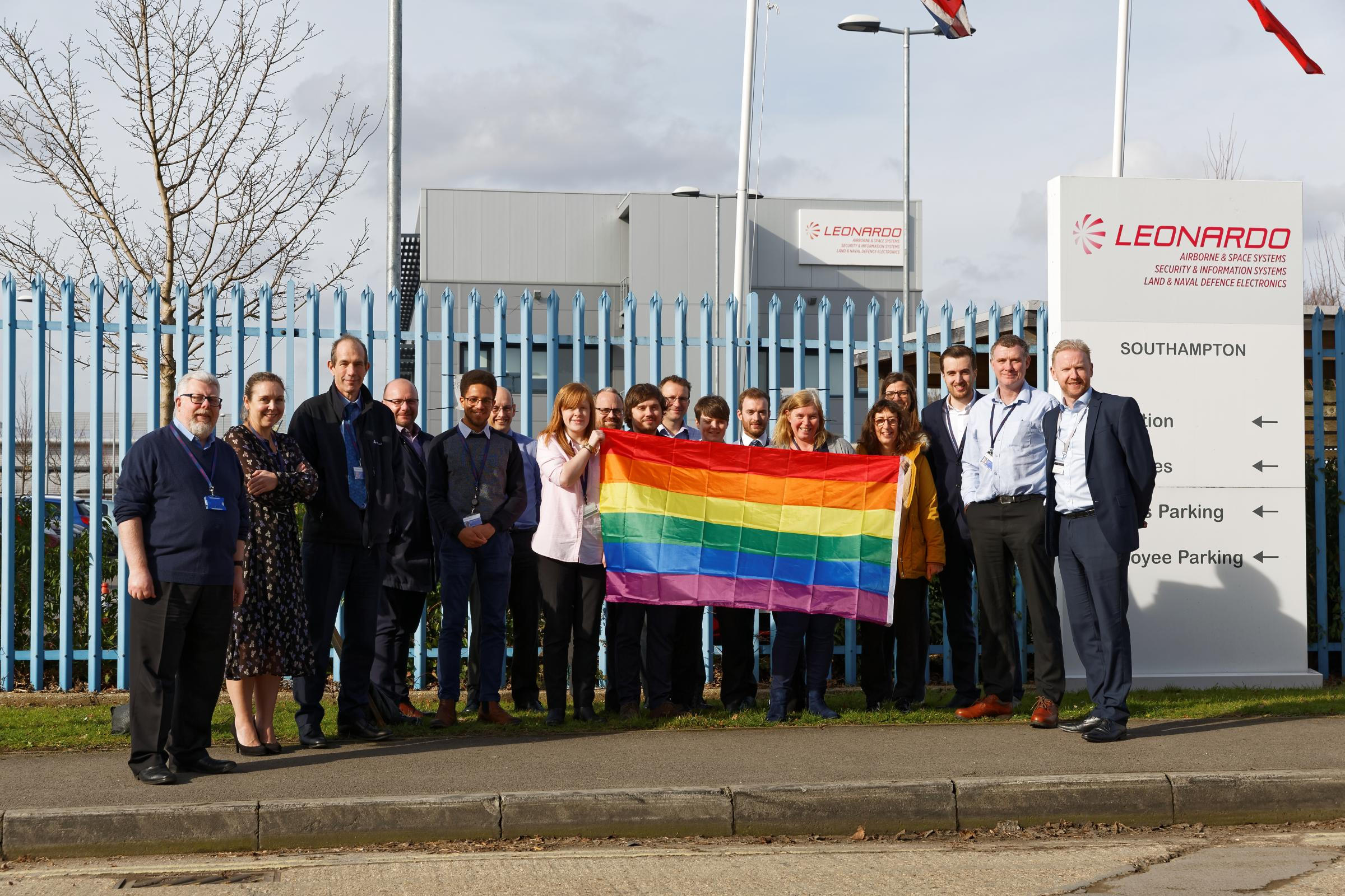 Leonardo staff with the LGBT flag outside their Southampton site